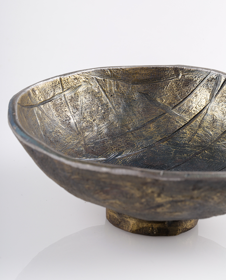 unique handmade metal bowl with base